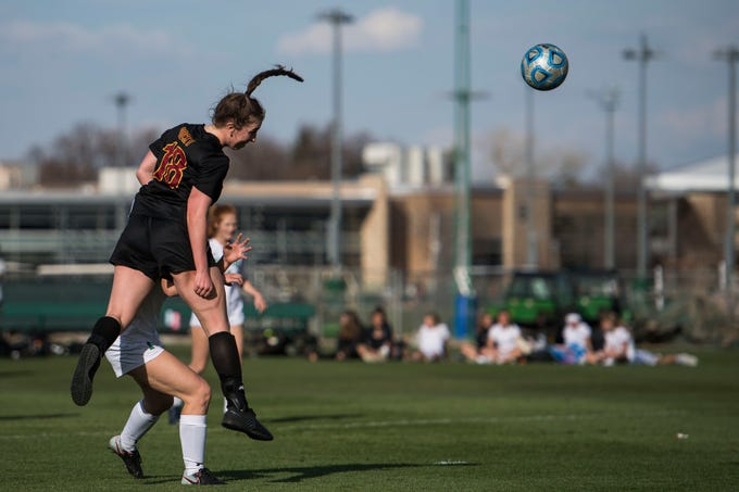 Rocky Mountain High School senior Mikayla Eccher (18) heads the ball in to put Rocky up 2-0 over Fossil Ridge High School on Friday, April 4, 2019, at Colorado State University's soccer field in Fort Collins, Colo.