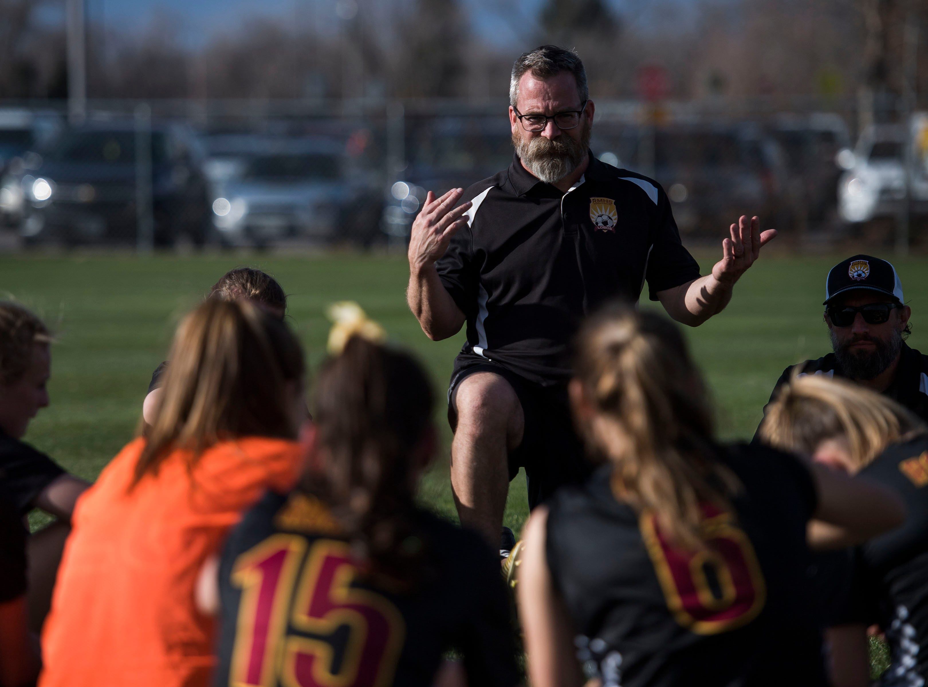 Rocky Mountain High School head coach Ron Clark talks with his team at halftime during a game against Fossil Ridge High School on Friday, April 4, 2019, at Colorado State University's soccer field in Fort Collins, Colo.