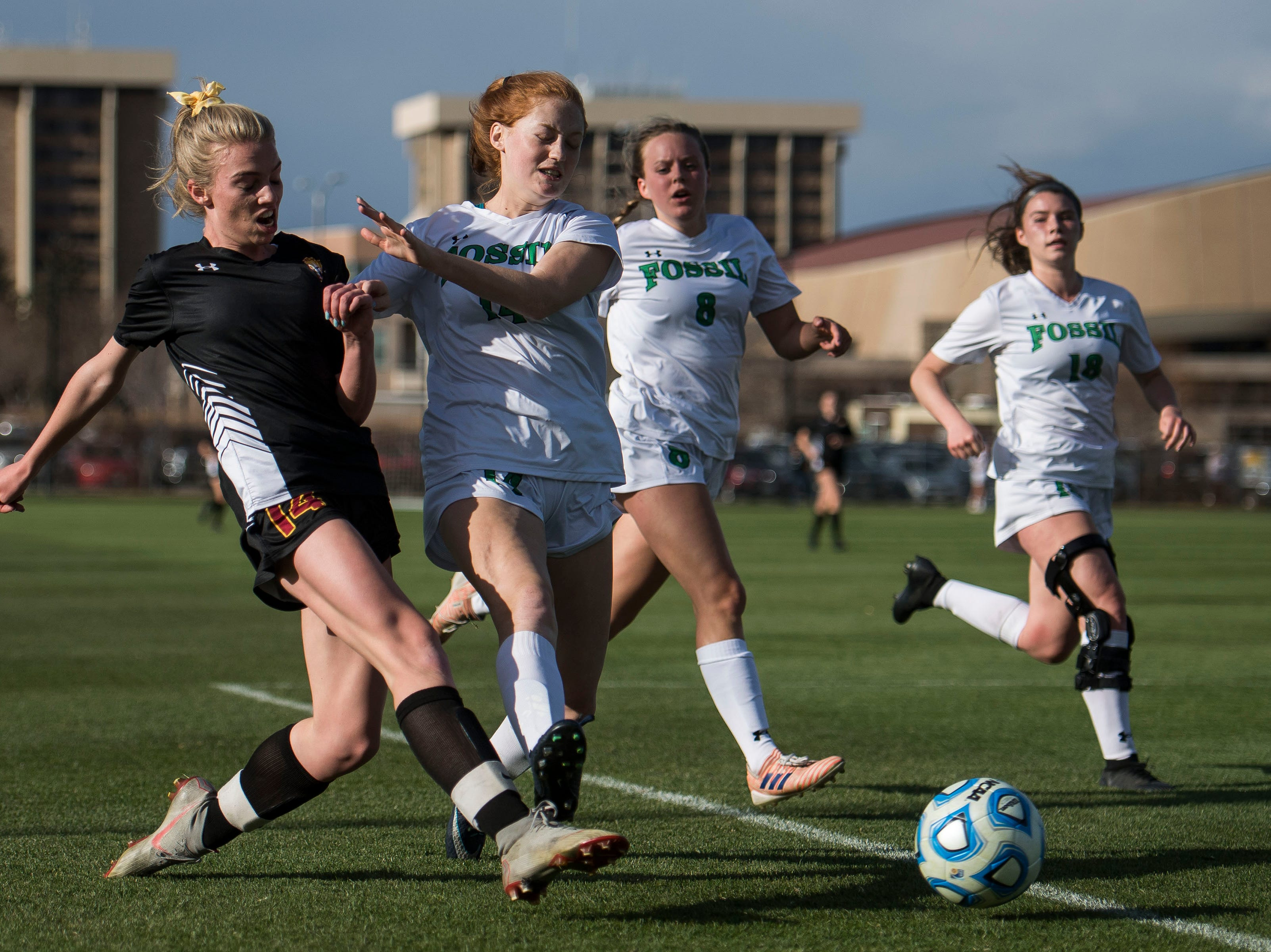 Rocky Mountain High School sophomore Mya Johnson (14) gets a shot past Fossil Ridge High School freshman Dana Leary (14) on Friday, April 4, 2019, at Colorado State University's soccer field in Fort Collins, Colo.