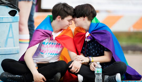 """""""He's caring,"""" Ryker Carroll, 17, left, says of Kyler Dotson, 17, right, while at PRIDE Cape Coral on Saturday. The inaugural event featured a parade and live music. """"I like his smile,"""" Dotson said of Carroll."""
