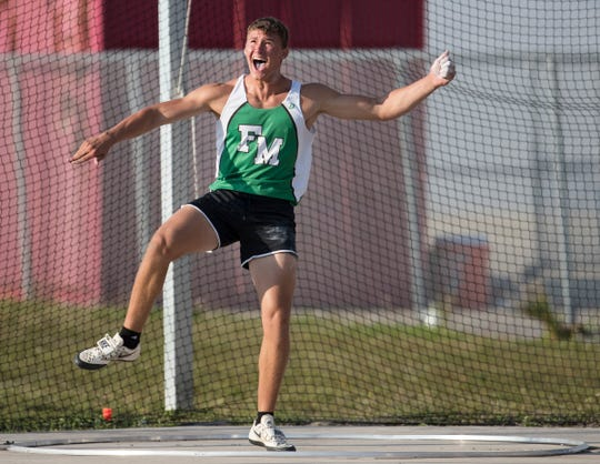 Fort Myers High School's Jacob Lemmon competes in the boys discus on Friday during the Lee County Athletic Conference track and field championships at South Fort Myers. Lemmon won the event.