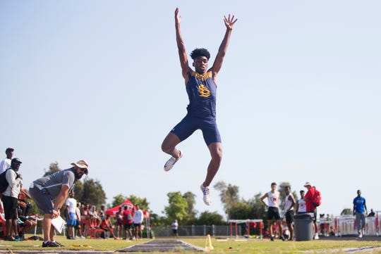 Lehigh Senior High School's Jeremiah Davis competed in the boys long jump during the Lee County Athletic Conference track and field championships at South Fort Myers.