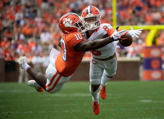 Clemson center back A.J. Terrell (8) blocks a pass intended for Clemson wide receiver Joseph Ngata (10) during the Spring Game at Memorial Stadium Saturday, April 6, 2019.