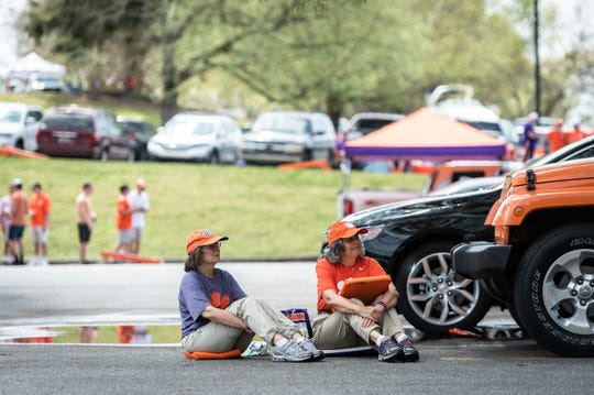 Fans tailgate in the parking lot before the Clemson Spring Game at Memorial Stadium Saturday, April 6, 2019.
