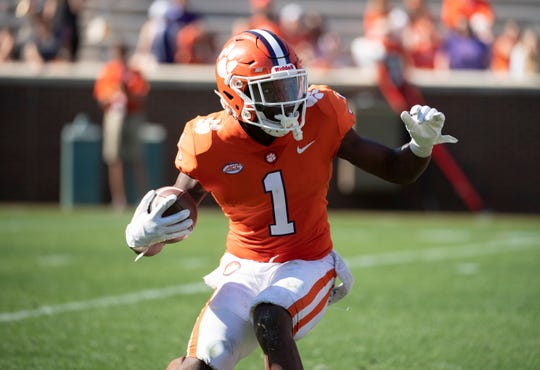 Clemson's Derion Kendrick (1) runs with the ball during the spring game at Memorial Stadium Saturday, April 6, 2019.