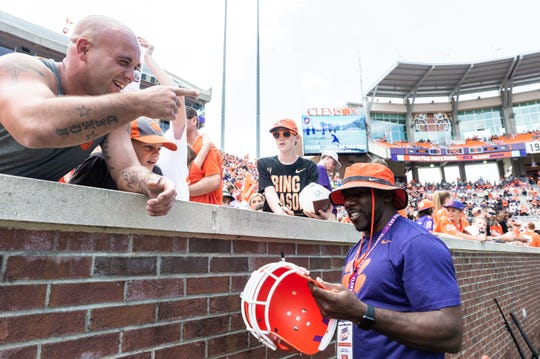 "Clifford ""CJ"" Spiller Jr. formerly a running back with Clemson from 2006-2009, signs autographs for fans before the Spring Game at Memorial Stadium Saturday, April 6, 2019."