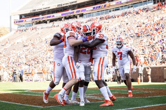 Clemson defensive back Sheridan Jones (26) celebrates with teammates after a touchdown after an interception during the Spring Game at Memorial Stadium Saturday, April 6, 2019.