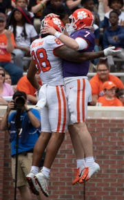 Clemson tight end Braden Galloway (88) and quarterback Chase Brice (7) celebrate a touchdown during the Spring Game at Memorial Stadium Saturday, April 6, 2019.