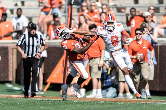 Clemson center back A.J. Terrell (8) stiff arms Clemson running back Lyn-J Dixon (23) after intercepting a pass during the Spring Game at Memorial Stadium Saturday, April 6, 2019.