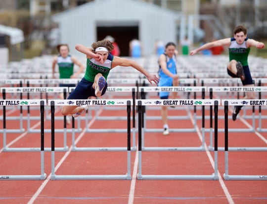 Glacier's Drew Deck runs in the 100m Hurdles during Friday's track meet against Great Falls High at Memorial Stadium.