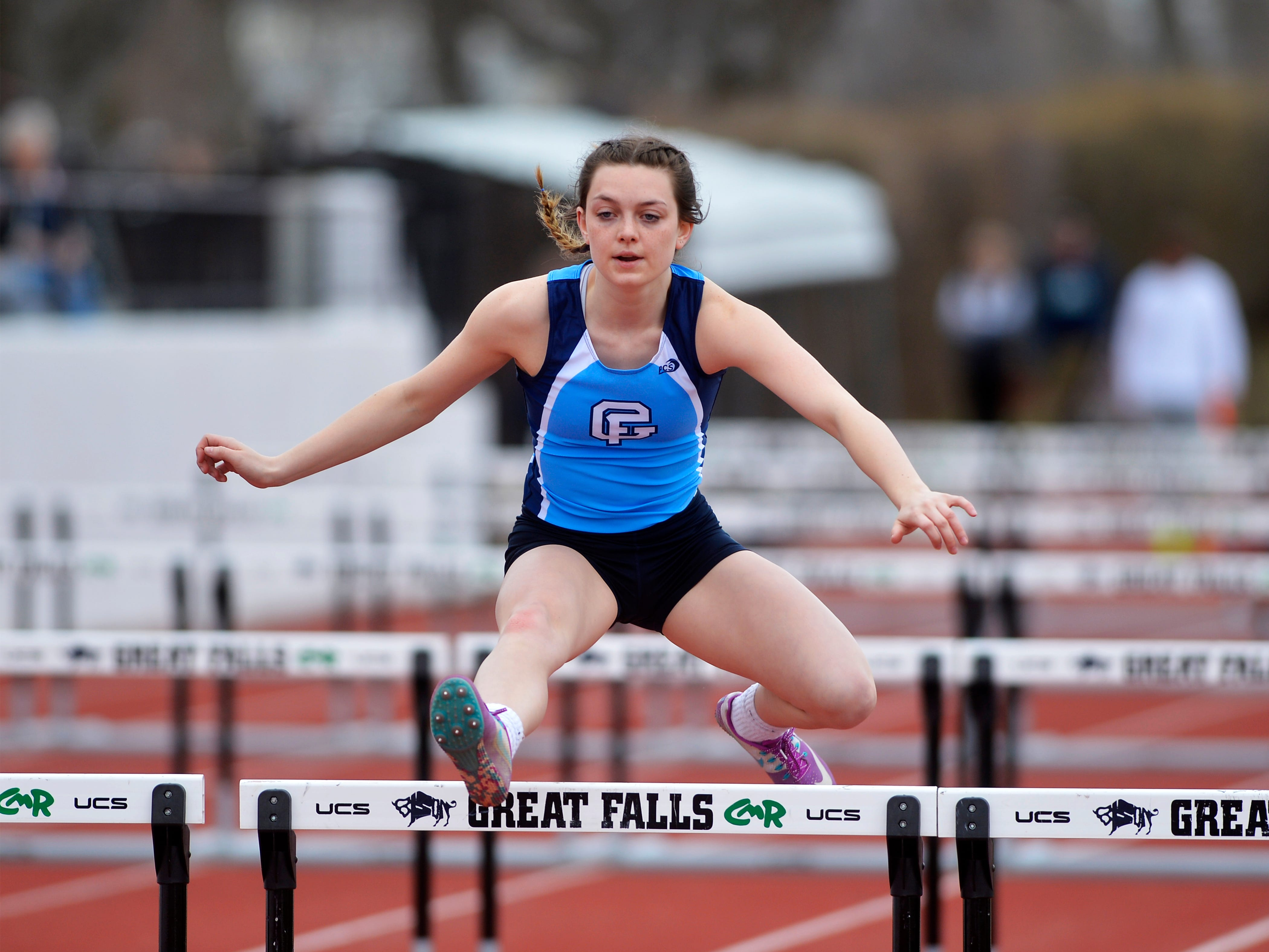 Great Falls High's Maraya Christiansen runs in the 100m hurdles in Friday's track meet against Glacier.
