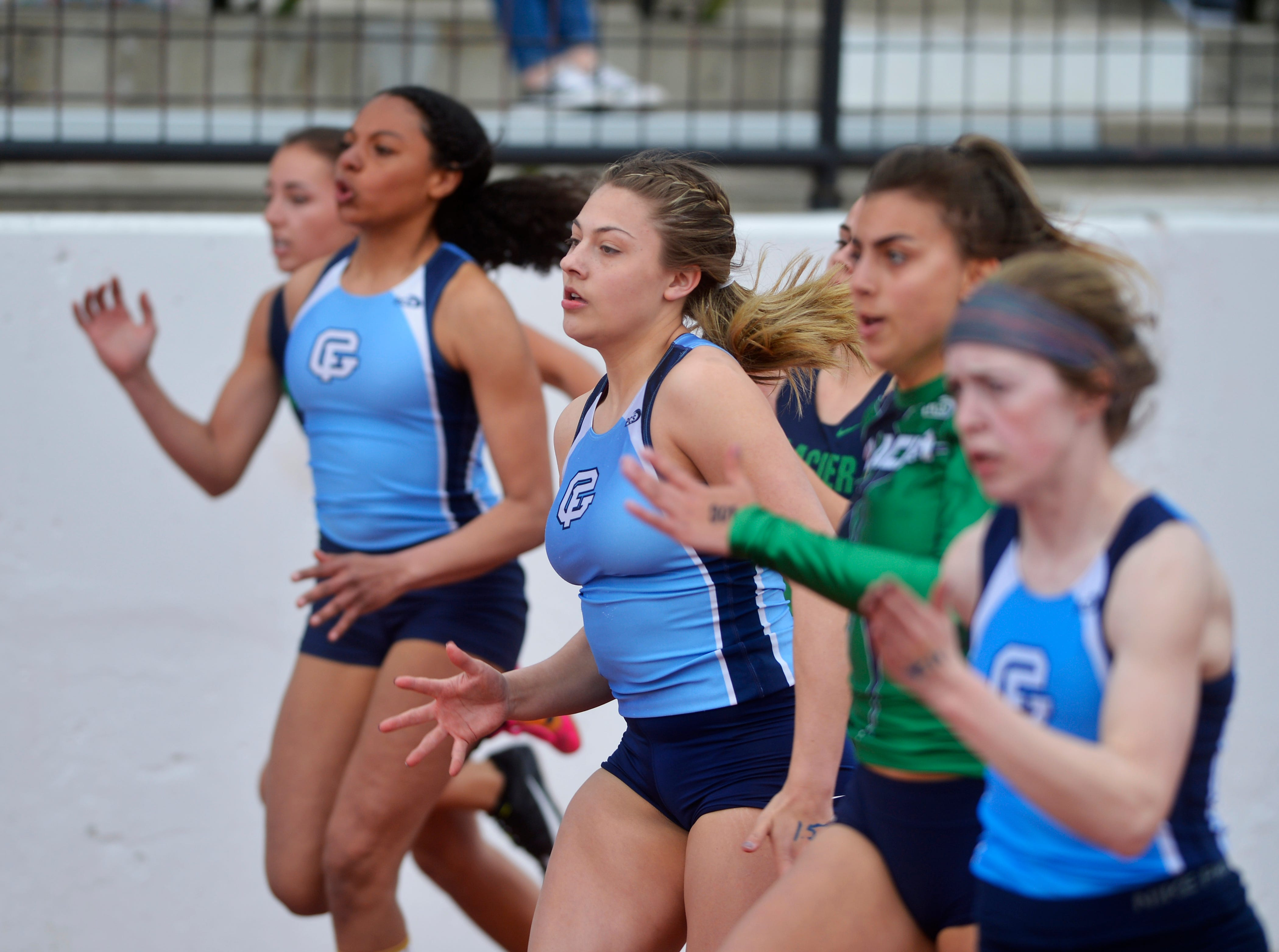 The girls field of the 100m dash during Friday's track meet between Great Falls High and Glacier High.