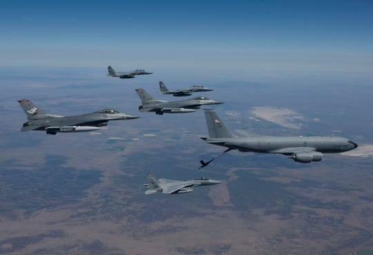 Col. Larry Gardner flies an F-15C that is being refueled (bottom) during an exercise near Klamath Falls, Ore., in 2011. The refueling plane supplying the gas is a KC-135R, which Col. Gardner will learn to fly in his new mission as Wing Commander of the 141st Air Refueling Wing at Fairchild Air Force Base in Spokane.