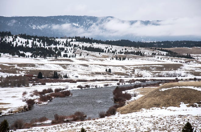 In this March 27, 2019 photo, the Madison River flows in Ennis, Mont. Ennis residents are worried about any new rules or limitations on the Madison River, one of the most famous fly-fishing destinations in the world. (Rachel Leathe/Bozeman Daily Chronicle via AP)