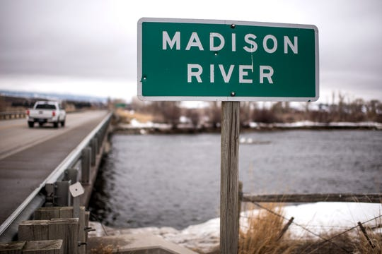 In this March 27, 2019 photo, the Madison River flows under Highway 287 in Ennis, Mont. Ennis residents are worried about any new rules or limitations on the Madison River, one of the most famous fly-fishing destinations in the world. (Rachel Leathe/Bozeman Daily Chronicle via AP)