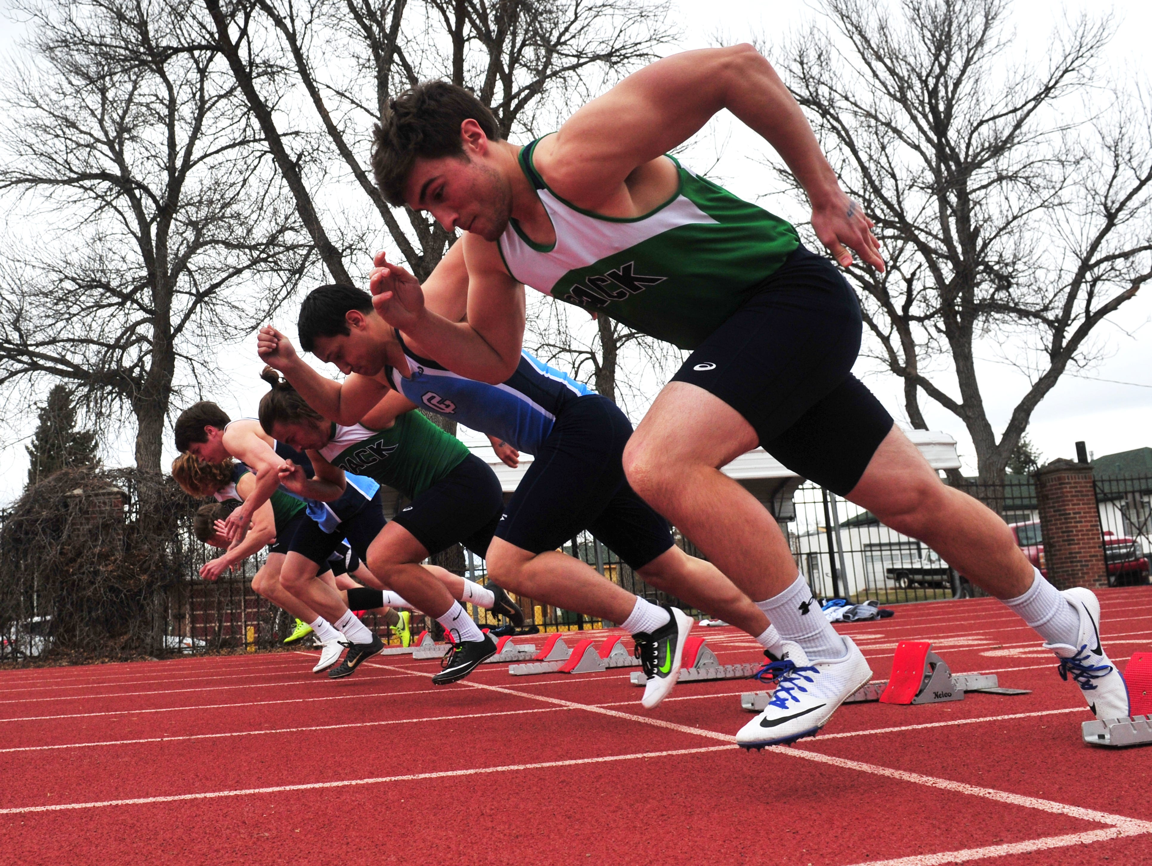 The boys 100m dash field leaves the starting blocks in Friday's dual track meet between Great Falls High and Glacier High.