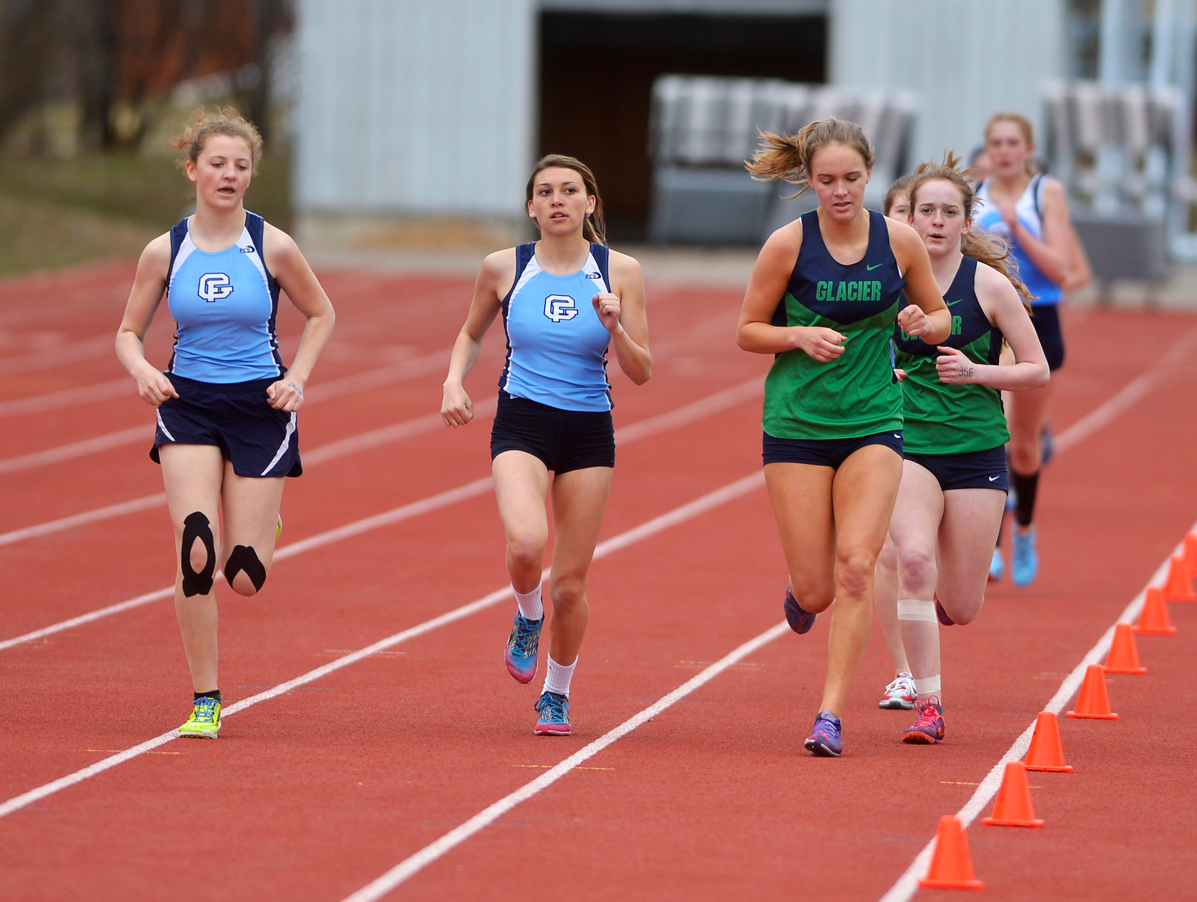 The girls 1600m run during Friday's track meet between Great Falls High and Glacier.