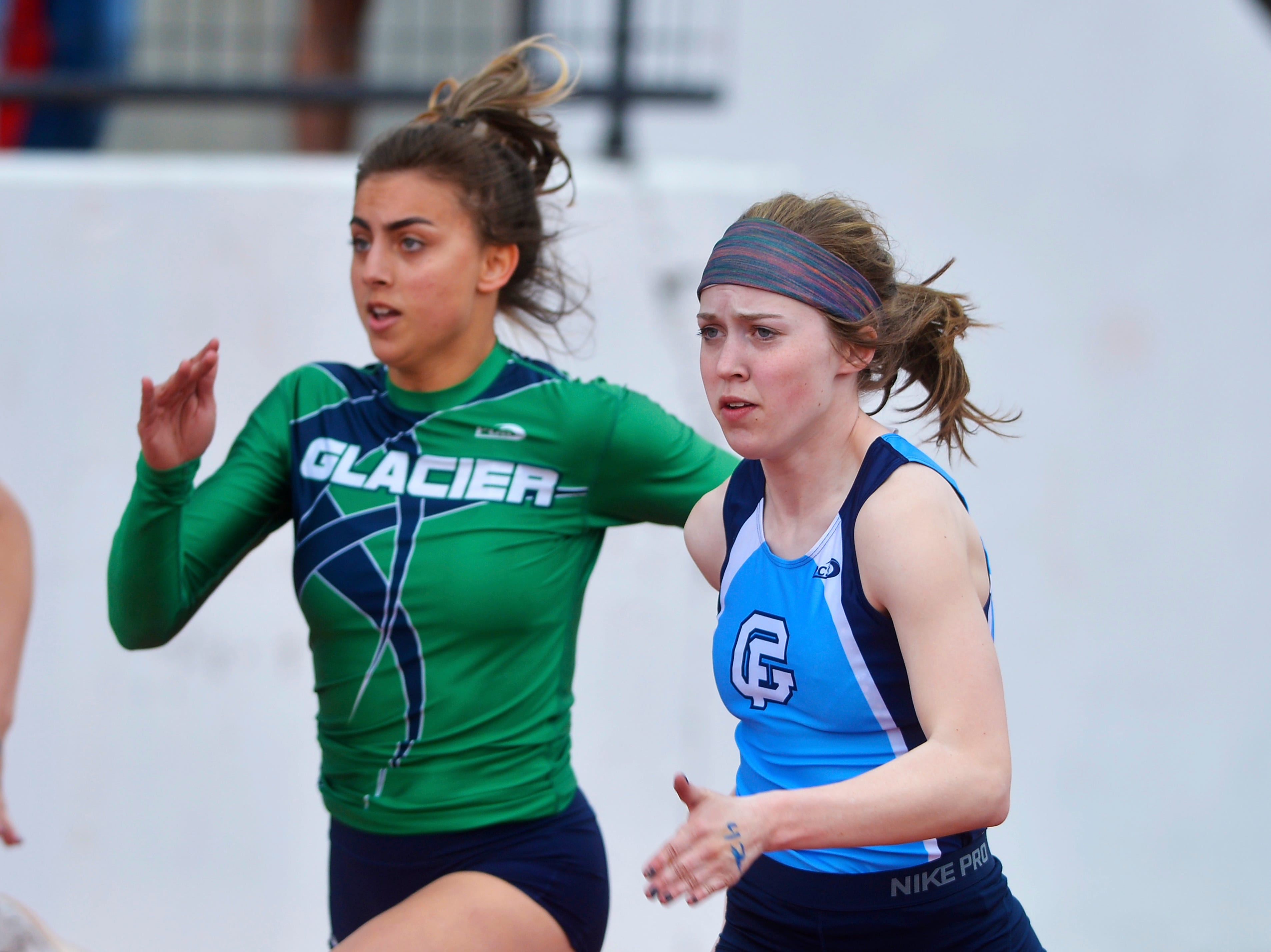 Great Falls High's Parker Sanford edges ahead of the field in the 100m dash at Friday's dual track meet against Glacier High.