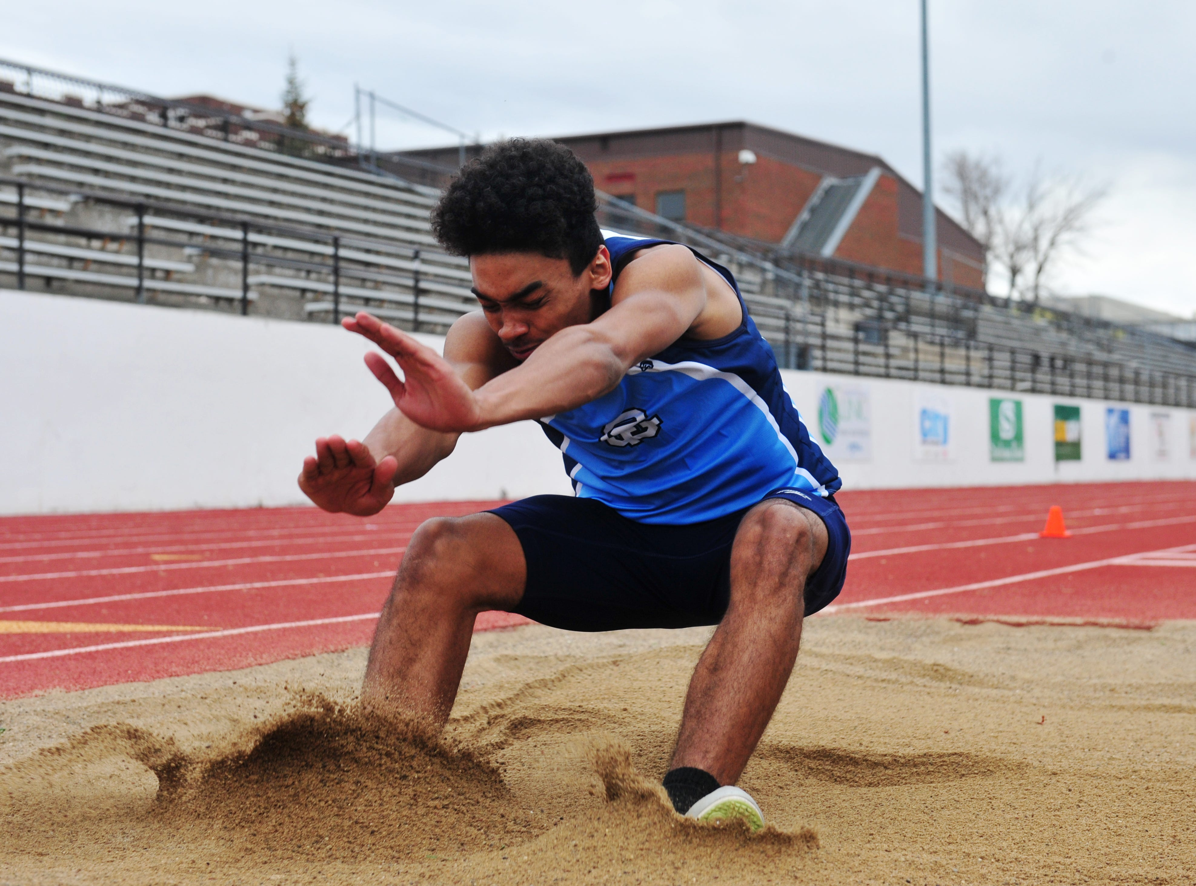 Great Falls High's Ron Cooper competes in the triple jump during Friday's dual track meet against Glacier.