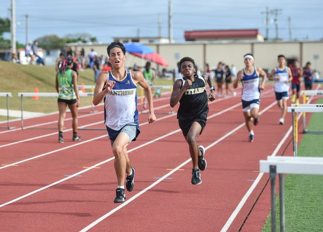 Competitors of various school race in the IIAAG Track and Field Men's 3,000 meters at Guam High School in this April 5 file photo. Fourth-quarter sports for the Interscholastic Sports Association have been canceled.