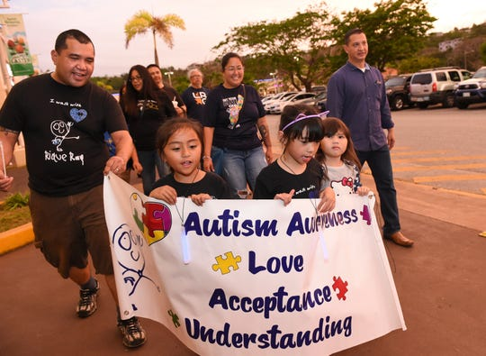 Guam's autism community and supporters participate in the Autism Parade of Kids/Light it up blue event at Agana Shopping Center in Hagåtña, April 5, 2019.