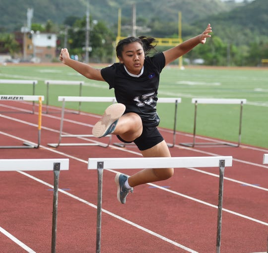 A competitor clears a hurdle at a IIAAG Track and Field at Guam High in this April 5 file photo.