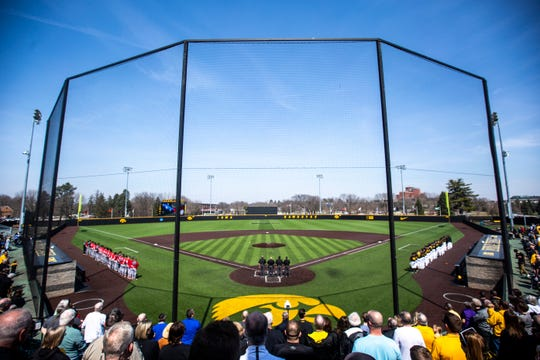 Rutgers and Iowa players stand for the national anthem during a NCAA Big Ten Conference baseball game on Saturday, April 6, 2019, at Duane Banks Field in Iowa City, Iowa.
