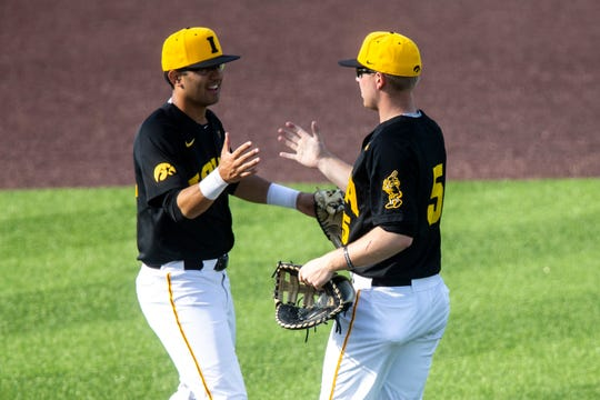 Iowa infielder Matthew Sosa, left, goes for an embrace with Zeb Adreon (5) during a NCAA Big Ten Conference baseball game on Saturday, April 6, 2019, at Duane Banks Field in Iowa City, Iowa.
