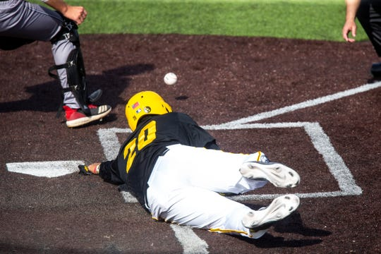 Iowa's Izaya Fullard slides home safely during the Hawkeyes' 9-5 win Saturday afternoon against Rutgers at Banks Field.