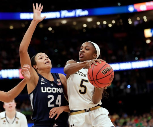 Notre Dame guard Jackie Young (5) drives to the basket as Connecticut forward Napheesa Collier (24) defends during the second half of a Final Four semifinal of the NCAA women's college basketball tournament Friday, April 5, 2019, in Tampa, Fla. (AP Photo/John Raoux)