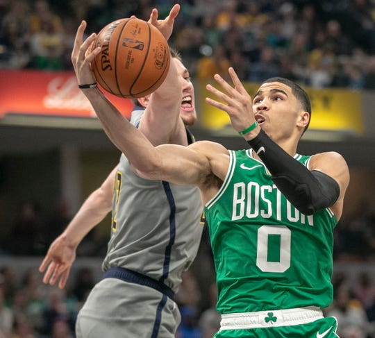 T.J. Leaf of the Indiana Pacers defends Jayson Tatum of the Boston Celtics, Boston at Indiana, Bankers Life Fieldhouse, Indianapolis, Friday, April 5, 2019. Boston won 117-97.