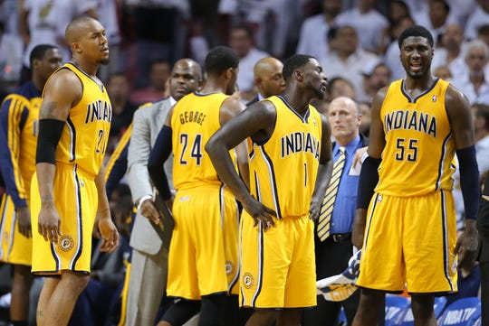 Roy Hibbert (55) speaks to Lance Stephenson (1) as the Indiana Pacers play against the Miami Heat during Game 6 of the Eastern Conference Finals inside American Airlines Arena, Friday, May 30, 2014, in Miami, Fla.