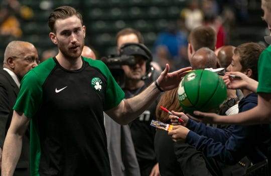 Gordon Hayward of the Boston Celtics slaps hands with a few fans as he exits the floor, Boston at Indiana, Bankers Life Fieldhouse, Indianapolis, Friday, April 5, 2019. Boston won 117-97.