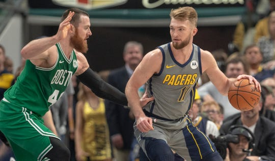 Aron Baynes of the Boston Celtics defends Domantas Sabonis of the Indiana Pacers, Boston at Indiana, Bankers Life Fieldhouse, Indianapolis, Friday, April 5, 2019. Boston won 117-97.