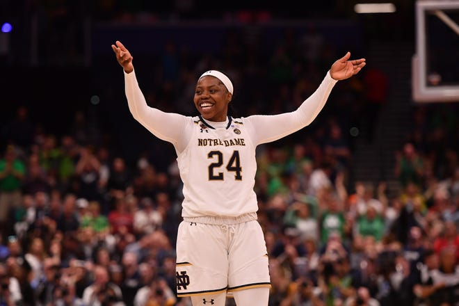 Notre Dame Fighting Irish guard Arike Ogunbowale (24) celebrates during the final seconds of the second half in the semifinals of the women's Final Four of the 2019 NCAA Tournament against the UConn Huskies at Amalie Arena.