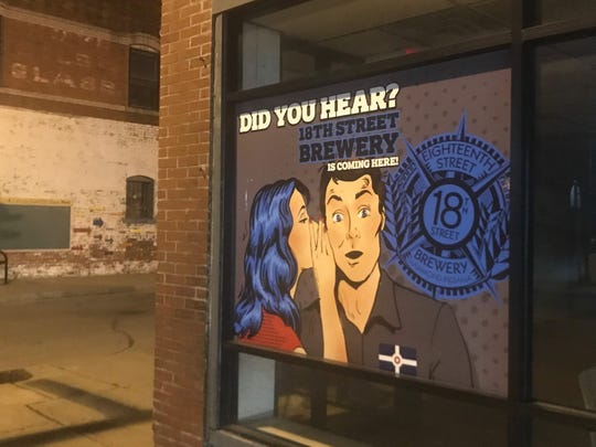 """A sign that reads """"Did you hear? 18th Street Brewery is coming here!"""" is seen at 2829 E. 10th St., the first Indianapolis site for Love Handle restaurant."""
