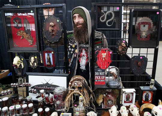 Jared Ruch, from Willmington IL., of Gypsy Macabre Inc., displays his goods during the Indianapolis Oddities and Curiosities Expo at the Indiana State Fair Grounds on Saturday, April 6, 2019.