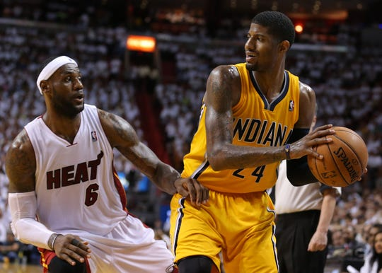 Lebron James (6) defends Paul George (24) during Game 6 of the Eastern Conference Finals between the Indiana Pacers and the Miami Heat inside American Airlines Arena, Friday, May 30, 2014, in Miami, Fla.