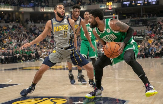 Cory Joseph of the Indiana Pacers defends Kyrie Irving of the Boston Celtics, Boston at Indiana, Bankers Life Fieldhouse, Indianapolis, Friday, April 5, 2019. Boston won 117-97.