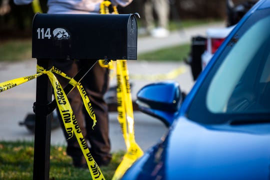 Yellow tape is tied around the mailbox as police investigators respond to a scene of a suspicious death on Friday, April 5, 2019, at 114 Green Mountain Drive in Iowa City, Iowa.