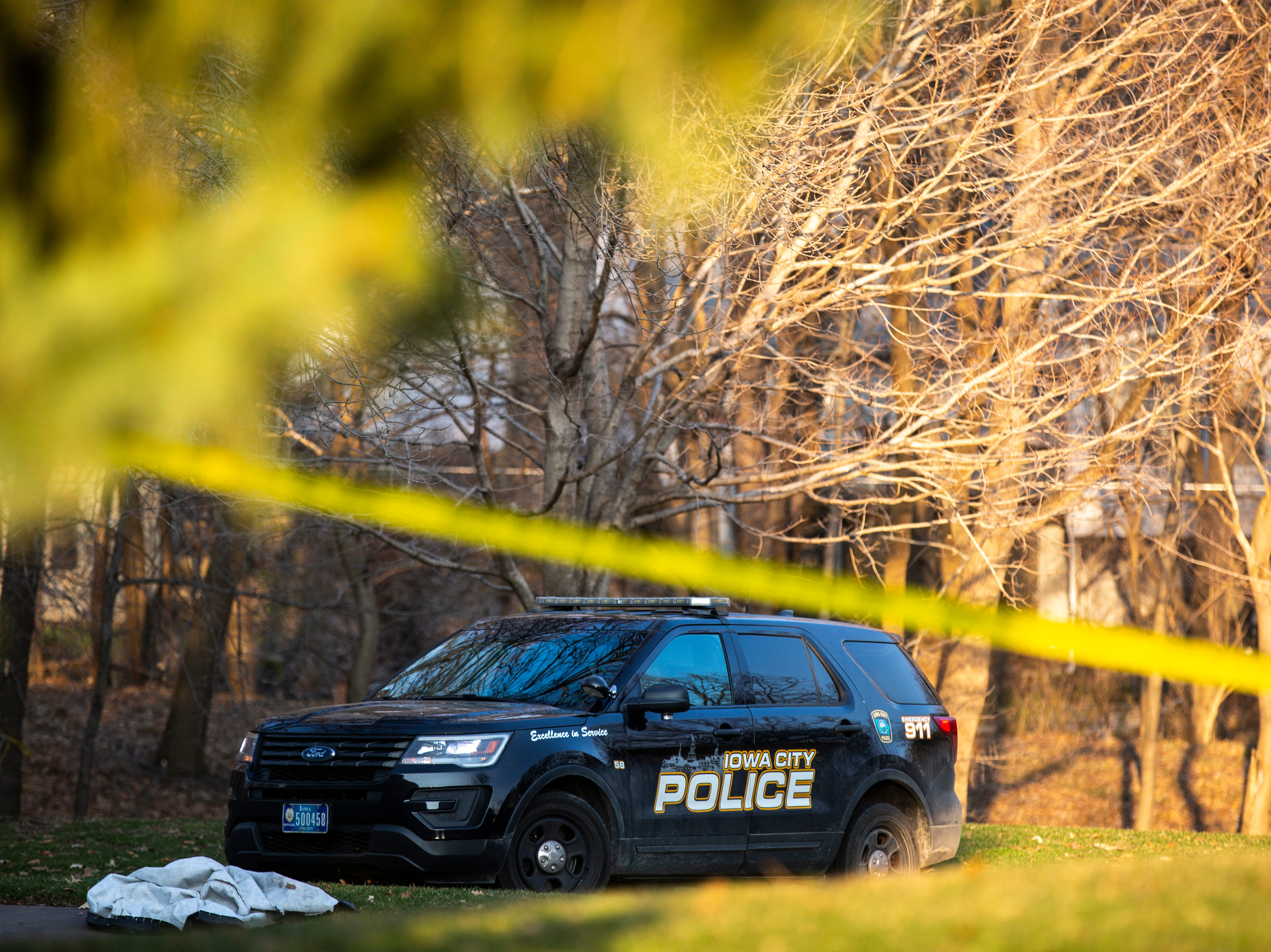 A police car is parked in the backyard of the residence while investigators respond to a scene of a suspicious death on Friday, April 5, 2019, at 114 Green Mountain Drive in Iowa City, Iowa.