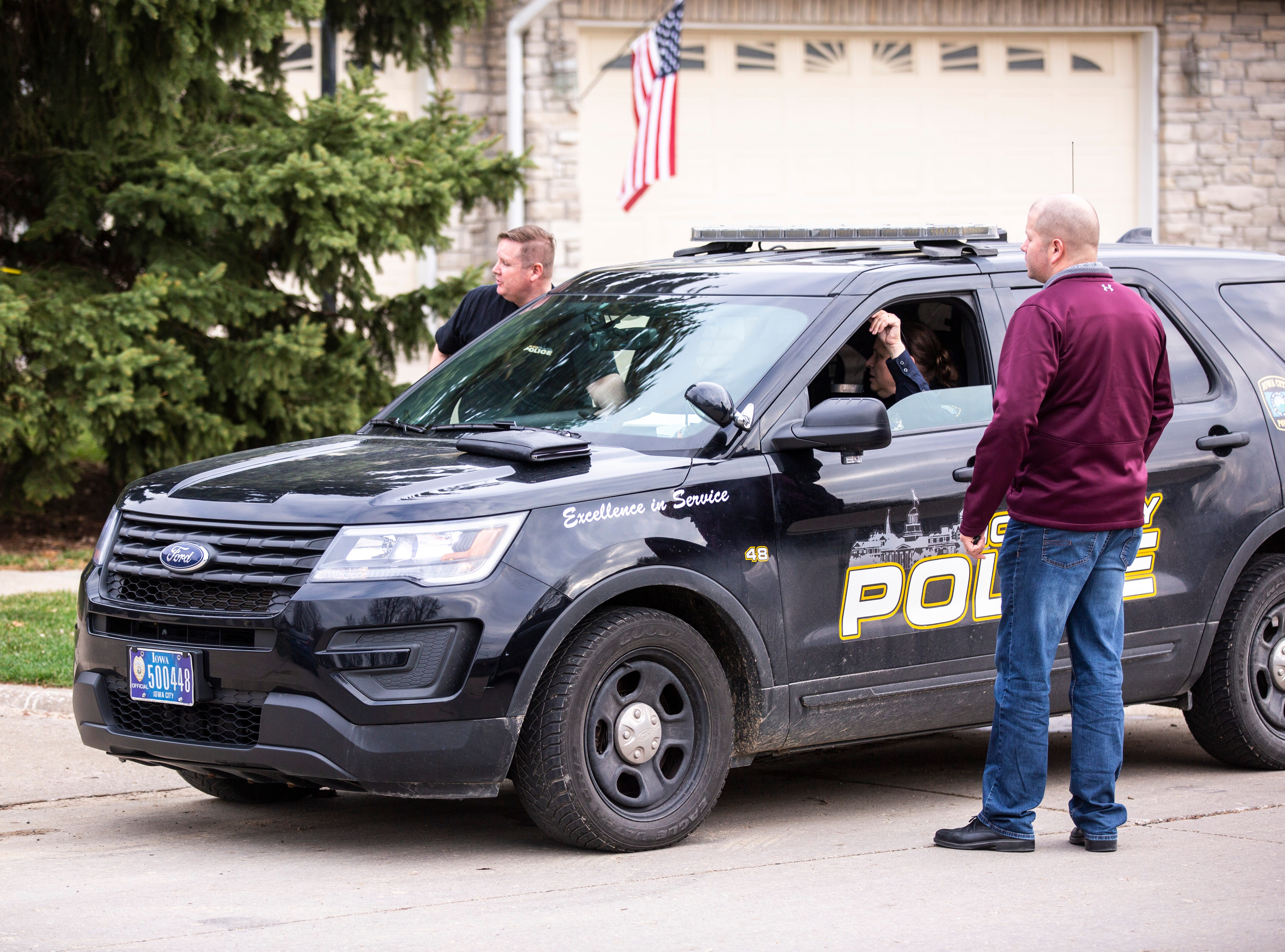 Police investigators respond to a scene of a suspicious death on Friday, April 5, 2019, at 114 Green Mountain Drive in Iowa City, Iowa.