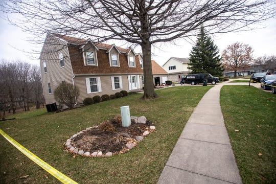 Police investigators respond to a scene of a suspicious death on Friday, April 5, 2019, at 114 Green Mountain Drive in Iowa City, Iowa.