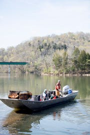 A recovered refrigerator is brought back to the boat landing during a river clean up of the Clinch River near Solway Park in Oak Ridge, Tennessee on Saturday, April 6, 2019. Dozens of volunteers cleaned up several areas on the river of debris and trash.