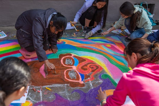 Members of Farragut middle school National Junior Art Honors Society finish up their drawing during the Dogwood Arts annual Chalk Walk in Market Square Saturday, April 6, 2019. Dogwood Arts is one of the nonprofits paricipating in Big Give Knox effort on Dec. 3, 2019.