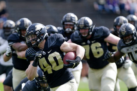 Purdue running back Zander Horvath (40) runs the ball during the first quarter of the Purdue University spring game, Saturday, April 6, 2019, at Ross-Ade Stadium in West Lafayette.(Nikos Frazier | The Journal & Courier)