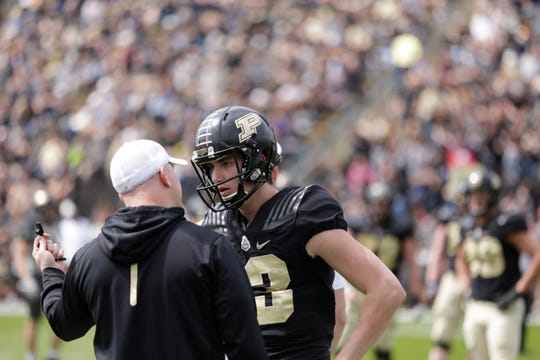 Purdue head coach Jeff Brohm talks with quarterback Jack Plummer (13) during the second quarter of the Purdue University spring game, Saturday, April 6, 2019, at Ross-Ade Stadium in West Lafayette.(Nikos Frazier | The Journal & Courier)
