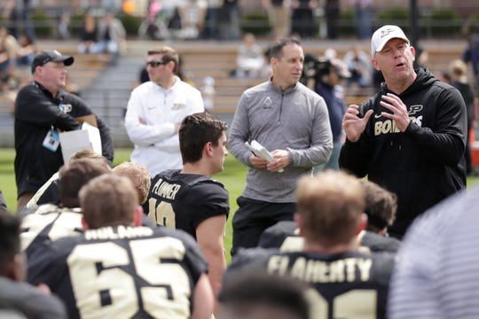 Purdue head coach Jeff Brohm talks in the post-game huddle after the Purdue University spring game, Saturday, April 6, 2019, at Ross-Ade Stadium in West Lafayette. The defense won, 53-39, using a modified scoring system.