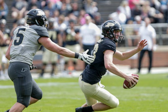 Purdue defensive end George Karlaftis (5) pressures Purdue quarterback Jack Plummer (13) during the second quarter of the Purdue University spring game, Saturday, April 6, 2019, at Ross-Ade Stadium in West Lafayette.(Nikos Frazier | The Journal & Courier)