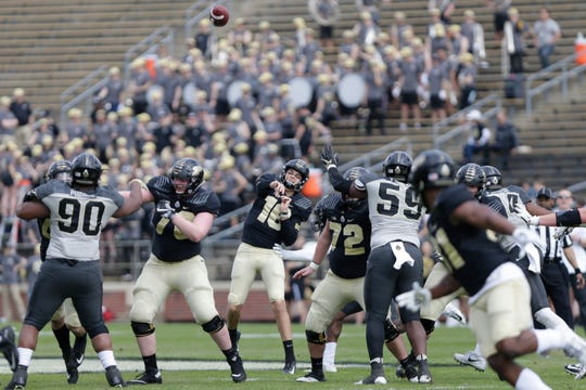 Purdue quarterback Aidan O'Connell (16) throws during the first quarter of the Purdue University spring game, Saturday, April 6, 2019, at Ross-Ade Stadium in West Lafayette.(Nikos Frazier | The Journal & Courier)